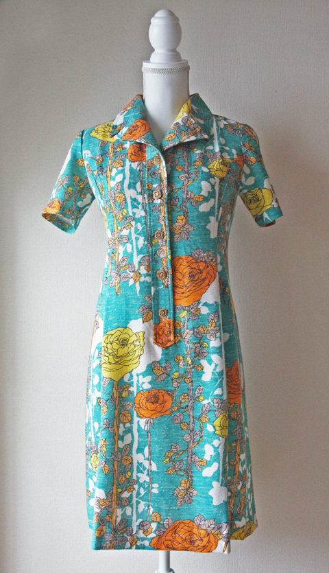Short turquoise blue dress with orange and yellow floral pattern 1