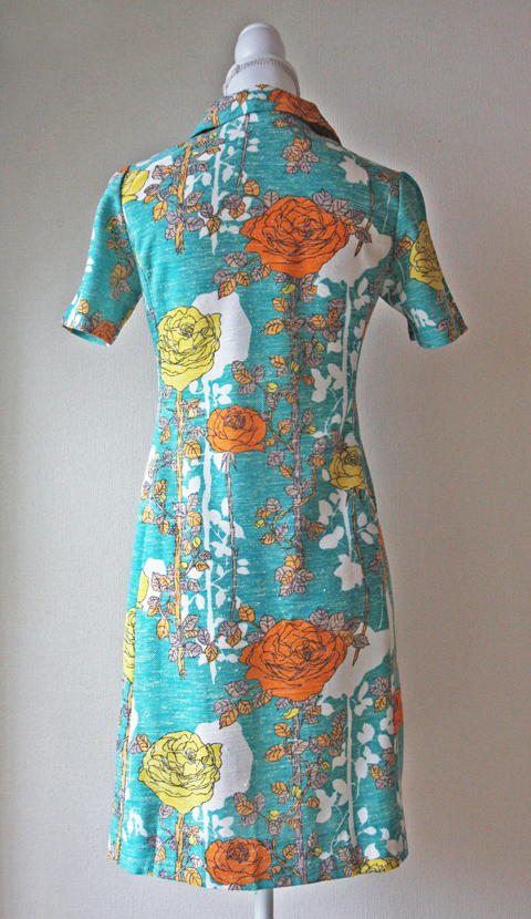Short turquoise blue dress with orange and yellow floral pattern 2