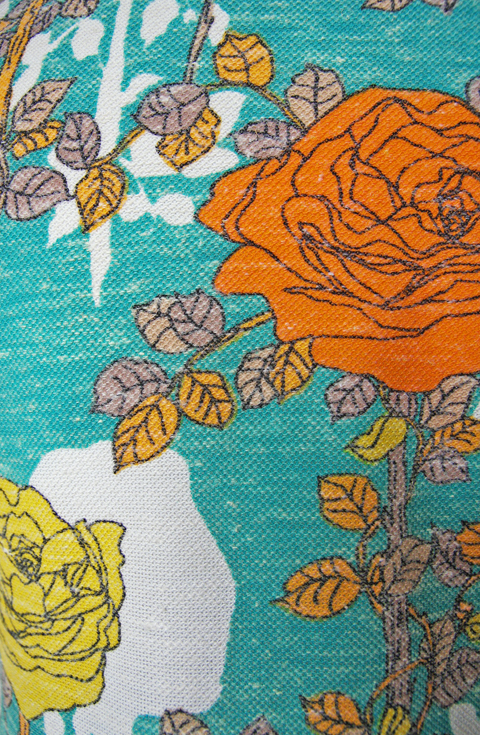 Short turquoise blue dress with orange and yellow floral pattern 6