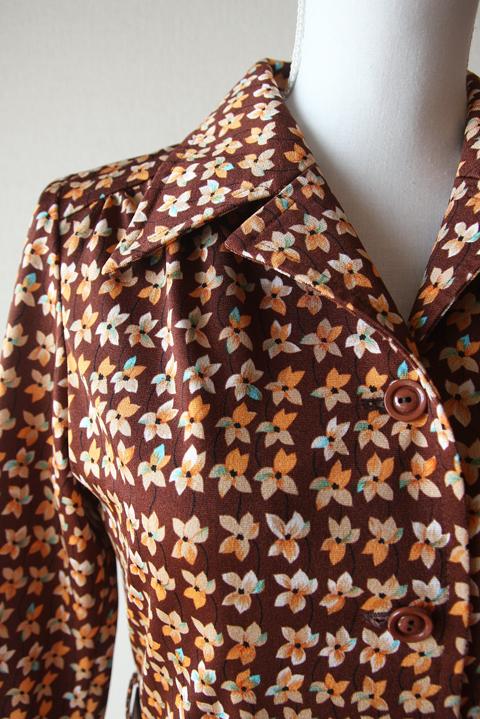Orange and turquoise pinwheel flower print dress